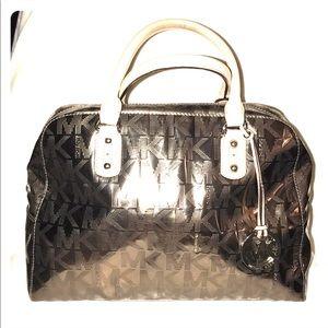 Micheal Kors gold metallic handbag.